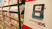 Nintendo's handheld game console 3DS and its game titles are displayed at a Tokyo electric shop on July 29, 2001. Japan's Nintendo on July 28, 2011 reported a first-quarter loss and lowered its annual forecast, citing the strong yen, a lack of new hit game titles, and research and marketing costs. (TOSHIFUMI KITAMURA/AFP/Getty Images)