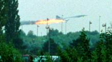 Flames come out of the Air France Concorde seconds before it crashed in Gonesse near Paris Roissy airport in this file photo from July 25, 2000. Continental Airlines and five men went on trial on Tuesday for their alleged role in the crash of an Air France Concorde that killed 113 people in 2000 and brought an end to an era of luxury supersonic travel. Picture taken July 25, 2000. REUTERS/Andras Kisgergely/Files (TRANSPORT CRIME LAW DISASTER) (ANDRAS KISGERGELY/ANDRAS KISGERGELY/REUTERS)
