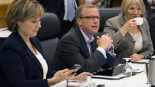 British Columbia Premier Christy Clark, Saskatchewan Premier Brad Wall and Newfoundland and Labrador Premier Kathu Dunderdale, left to right, wait for the start of the morning session at the annual Council of the Federation meeting in Halifax on Thursday, July 26, 2012. (Andrew Vaughan/THE CANADIAN PRESS)