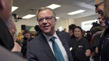 Brad Wall greets supporters during the Saskatchewan Party's election campaign kick-off in Saskatoon, Sask. on March 8, 2016. (Michael Bell/THE CANADIAN PRESS)