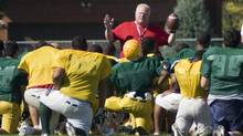 Toronto Mayor Rob Ford, in red, coaches football at Don Bosco Catholic Secondary School in Toronto on Wednesday, September 12, 2012. (Matthew Sherwood for The Globe and Mai)