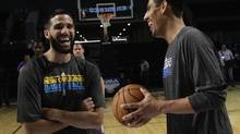Orlando Magic centre Gustavo Ayon (L) speaks with New Orleans Hornets guard Greivis Vasquez after organizing a clinic for disabled children during a NBA Cares outreach event in Mexico City October 6, 2012. As the world's top professional basketball league gears up for Sunday's preseason launch in Mexico City, National Basketball Association officials are hinting at permanent expansion south of the border. The Magic will play an exhibition game against the Hornets on October 7 in Mexico City. (HENRY ROMERO/REUTERS)