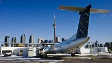 A Porter Airlines Bombardier Q400 turboprop aircraft is seen in Toronto February 23, 2009. (© Mark Blinch / Reuters/REUTERS)