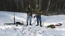Justin Bourque's Facebook profile has a photo of Mr. Bourque, left, with a friend, toting guns in a clearing, the snowy ground littered with shell casings.