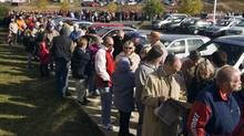 Hundreds of people wait in line outside a health clinic in Elmsdale, N.S. for their turn to be injected with the H1N1 flu vaccine on Tuesday, Oct. 27, 2009. (ANDREW VAUGHAN)