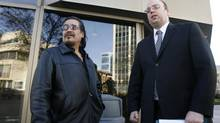 Rob Sinclair (left) ,cousin of Brian Sinclair, a man who died after a 34-hour wait in an emergency ward, and Vilko Zbogar, Toronto-based lawyer for the Sinclair family, are shown outside the Winnipeg Law Courts in this photo from Nov. 17, 2009. (Mike Deal/The Canadian Press)