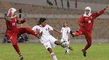Iranian players wearing headscarves battle for the ball at the West Asian Soccer Federation Women's Championship cup in Amman, Jordan on Oct. 1, 2005. The Quebec Soccer Federation announced Sunday it has decided to keep a ban against players wearing turbans on the field. (Muhammad Al-Kisswany/AP)