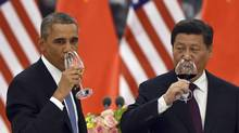 President Barack Obama and China's President Xi Jinping drink a toast at a lunch banquet in the Great Hall of the People in Beijing, Nov. 12, 2014. Presidents Obama and Xi jointly announced a landmark agreement Wednesday that includes new targets for carbon emissions reductions by the U.S. and a first-ever commitment by China to stop its emissions from growing by 2030. (GREG BAKER/NYT)