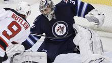 Winnipeg Jets goaltender Ondrej Pavelec (31) saves the shot from New Jersey Devils' Bobby Butler (9) during first period NHL action in Winnipeg on Thursday, February 28, 2013. (CP)