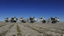 Trucks designed to produce vibrations cross a field during a seismic survey of the Niobrara formation in Colorado. (R.J. SANGOSTI/DENVER POST/R.J. SANGOSTI/DENVER POST)
