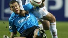 Monaco's Dado Prso (R) tussles with PSV Eindhoven's Wilfred Bouma (L) during their Champions League Group C soccer match at Louis II stadium in Monte Carlo, November 25, 2003. (Eric Gaillard/Reuters/Eric Gaillard/Reuters)