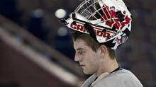 Team Canada's goalie Scott Wedgewood take a break during at the Canadian national junior hockey team practice in Edmonton, Sunday Dec. 25. (JASON FRANSON/The Canadian Press)