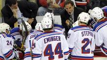 New York Rangers' John Tortorella instructs his team against the New Jersey Devils during the second period in game 3 of their NHL Eastern Conference Final hockey playoff game in Newark, New Jersey, May 19, 2012. (BILL KOSTROUN/REUTERS)