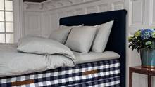Hastens sells sheet sets in their signature blue-and-white-checked fabric, telegraphing to those in the know the bed's prestige. (Philip Karlberg)