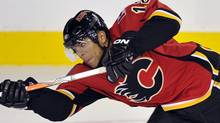 Calgary Flames captain Jarome Iginla takes a shot that scored a goal during the third period of their NHL pre-season hockey game against the Vancouver Canucks in Calgary, September 21, 2010. REUTERS/Todd Korol (TODD KOROL)