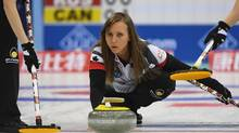 Canada's Rachel Homan releases the stone during their match against Russia at the Women's Curling World Championships in Beijing on March 24, 2017. (GREG BAKER/AFP/Getty Images)