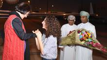 Iranian-Canadian professor Homa Hoodfar, left, arrives at Muscat airport, Oman, on Sept. 26, 2016. (Untitled/AP)