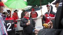 Tailgaters gather prior to a Stamps-Hamilton Tiger-Cats game in Calgary last month. (Chris Bolin For The Globe and Mail)