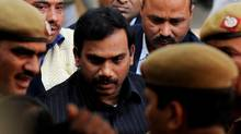 India's former telecoms minister Andimuthu Raja is escorted to court in New Delhi on Feb. 8, 2011. (Manan Vatsyayana/AFP/Getty Images/Manan Vatsyayana/AFP/Getty Images)