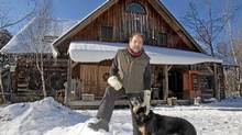 Peter Schiefenbaum outside his log home near Haliburton Ontario January 3, 2012. (FRED THORNHILL/FRED THORNHILL FOR GLOBE AND MAI)