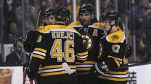 Boston Bruins center David Krejci (46) defenseman Torey Krug (47) center Ryan Spooner (51) (left) celebrate a goal by center Patrice Bergeron (37) (middle) during the third period against the Calgary Flames at TD Garden. (Bob DeChiara/USA Today Sports)