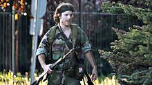 A heavily armed man that police have identified as Justin Bourque walks on Hildegard Drive in Moncton, New Brunswick, on Wednesday, June 4, 2014, after several shots were fired in the area. The man is suspected of killing three Royal Canadian Mounted Police officers. (Viktor Pivovarov/AP Photo/The Canadian Press, Moncton Times & Transcript, telegraphjournal.com)