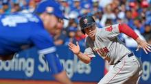 Boston Red Sox left fielder Brock Holt breaks for second base in the seventh inning of an 11-8 win over the Toronto Blue Jays on Sept. 11, 2016. (Dan Hamilton/USA Today Sports)