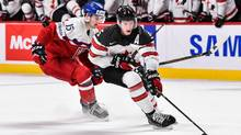 Thomas Chabot #5 of Team Canada skates the puck against Tomas Soustal #15 of Team Czech Republic during the 2017 IIHF World Junior Championship quarterfinal game at the Bell Centre on January 2, 2017 in Montreal, Quebec, Canada. (Minas Panagiotakis/Getty Images)