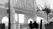 "Isaac Davis (Woody Allen) with Mary Wilke (Diane Keaton) in ""Manhattan"", a United Artists release. The two are silhouetted in the shadow of the Queensboro Bridge in New York as they chat on a Sutton Place bench. (United Artists)"