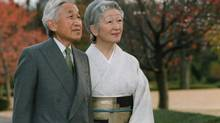 In this photo released by the Imperial Household Agency, Japan's Emperor Akihito poses with Empress Michiko for a photograph at East Gardens of Imperial Palace in Tokyo Monday, Dec. 1, 2008. (AP)