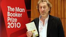 """Howard Jacobson with his prize-winning book """"The Finkler Question"""" at the Man Booker Prize ceremony in London on Tuesday, Oct. 12. (PAUL HACKETT/Reuters)"""