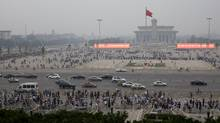 Visitors crowd Tiananmen Square and Tiananmen Gate in Beijing on June 4, 2013. (Andy Wong/AP)