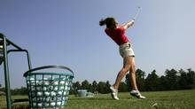 Ashley Brooker, 15, practices her golf swing on the driving range Aug. 10, 2006, in Pinehurst, N.C. (GERRY BROOME/AP)