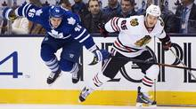 Toronto Maple Leafs defenceman Roman Polak (46) gets hit by Chicago Blackhawks centre Andrew Shaw (65) during first period NHL hockey action in Toronto on Friday, January 15, 2016. (Nathan Denette/THE CANADIAN PRESS)