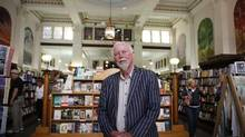 Owner Jim Munro of Munro's Books stands inside his neo-classical building in Victoria on July 29, 2013. The building was designed in 1909 for the Royal Bank of Canada and has since been in operation as a bookstore for nearly 50 years. (CHAD HIPOLITO For The Globe and Mail)