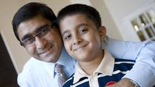 Yousuf Syed (L), shown at his apartment building in Toronto in July 2011, is a member of the parent council at Valley Park and a community leader in Thorncliffe Park whose son Aayez, 8 (R), will attend the Valley Park Middle School in a few years. (Kevin Van Paassen/The Globe and Mail) (Kevin Van Paassen/The Globe and Mail)