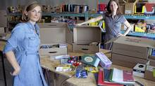 Ottawa mompreneurs Candace Derickx (left) and Laurie St-Julien assemble supply kits for delivery to schools (Bill Grimshaw for The Globe and Mail)