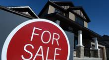 A sign advertises a new home for sale in Carleton Place, Ont., on March 17, 2015. THE CANADIAN PRESS/Sean Kilpatrick (Sean Kilpatrick/THE CANADIAN PRESS)
