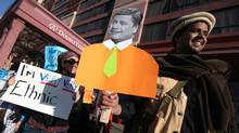 Demonstrators protest Conservative 'ethnic' photo ops at a rally on April 14, 2011. (Tim Fraser/The Globe and Mail/Tim Fraser/The Globe and Mail)