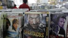 Pirated DVDs are seen at a store selling pirated CDs and DVDs in Beijing, April 21, 2011. While China implemented a six-month campaign in November aimed at counterfeit books, music, DVDs and software, all are still openly available on Chinese streets. (JASON LEE/REUTERS)