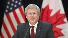 Canadian Prime Minister Stephen Harper delivers opening remarks at a business round table in New York on Sept. 26, 2013. (ADRIAN WYLD/THE CANADIAN PRESS)