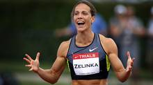 essica Zelinka, from London, Ont., celebrates her victory in the women's 100-metre hurdles at the Canadian Track and Field Championships in Calgary, Alta., Saturday, June 30, 2012. (The Canadian Press)