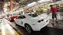 Workers on General Motors 'flex line' build automobiles in Oshawa, Ont. June 10/2011. (Kevin Van Paassen/Kevin Van Paassen/The Globe and Mail)
