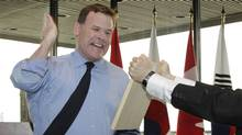 Foreign Affairs Minister John Baird prepares to chop at plank of wood in Ottawa, Sept. 22, 2012. (Serge Fournier/Department of Foreign Affairs)