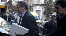 Poul Thomsen, left, the director of the IMF's mission to Greece, arrives at the Greek Ministry of Finance, in Athens, on Monday. (Petros Giannakouris/AP)