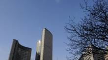 The two curved towers at Toronto city hall are visible above the elevated walkway at Nathan Phillip Square on February 28 2012. (Fred Lum/The Globe and Mail/Fred Lum/The Globe and Mail)