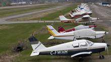 """Small planes lined up in the Mascouche airport taken in 2012. Early Sept. 3 a small airplane crashed in a Brantford, Ont. killing its sole occupant. The Transportation Safety Board of Canada said the aircraft was an """"amateur-built"""" Skybolt. (OLIVIER JEAN FOR THE GLOBE AND MAIL)"""