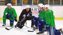 Willie Mitchell of the Los Angeles Kings smiles as he chats with former teammates on the Vancouver Canucks as they participate in an informal skate at UBC in Vancouver September 17, 2012. (Jeff Vinnick/The Globe and Mail)