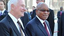 In this photo supplied by the Government Communications and Information Services (GCIS) South African President Jacob Zuma, right, and Governor General of Canada, David Johnston attend a welcoming ceremony in Cape Town, South Africa, on Tuesday, May 21, 2013. (Elmond Jiyane/AP)