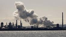 Steam billows from a stack at the Stelco plant in Hamilton, March 4, 2009. (MIKE CASSESE/REUTERS)